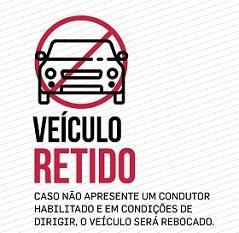 Imagem ilustrada com símbolo de proibido com o texto: Veículo retido (caso não apresente um condutor habilitado e em condições de dirigir o veículo é rebocado)